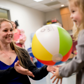 pediatric OT patient playing with ball