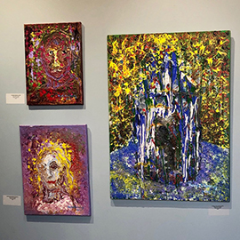 Three paintings from the art exhibit