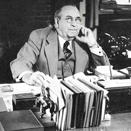 Albert Fitch at desk