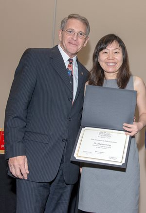 Dr. Wang with American Optometric Foundation President David Kirschen, OD, PhD, FAAO